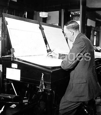 Man creating weather maps ca. 1936
