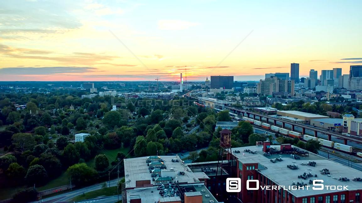 Atlanta Aerial Hyperlapse crossing over residential and railway toward sunset
