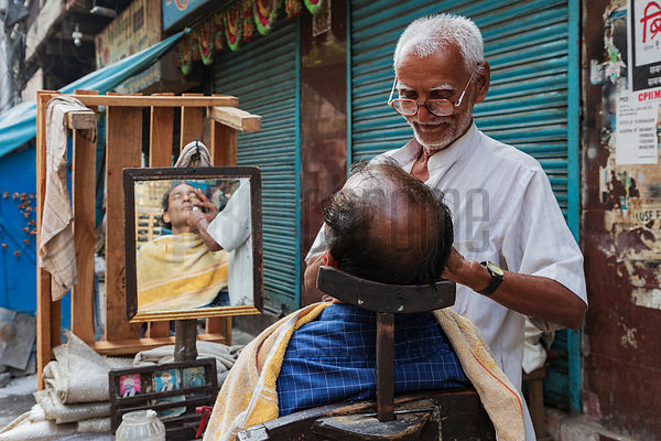 Street Barber Giving a Shave