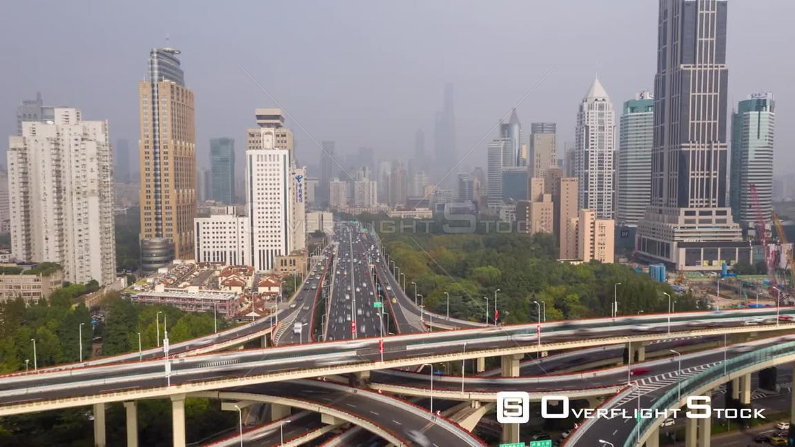 China Shanghai Aerial Hyperlapse moving along path of freeway and park from above
