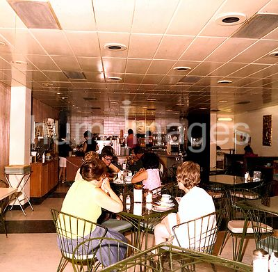 Athens - Chancery Office Building (possibly late 1970s) - People eating in cafeteria.