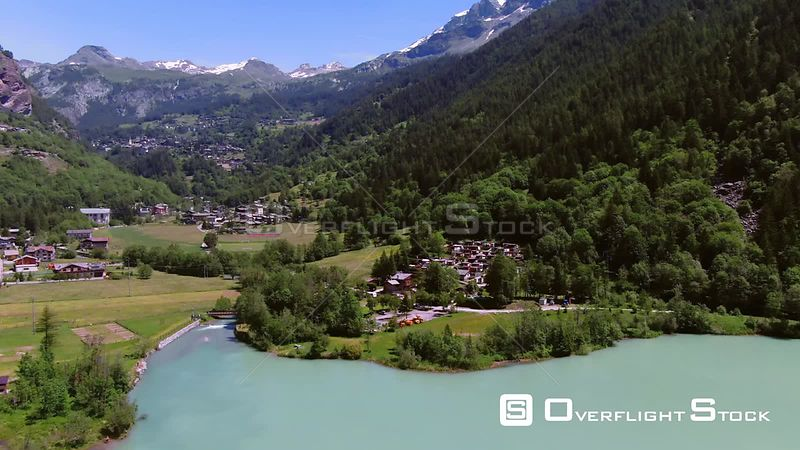 Aerial view of mountain villages by a lake in the Italian Alps
