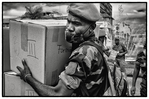"Malagasy army soldiers distribute samples of the ""so-called remedy"" Covid Organics, which is supposed to stop the spread of t..."