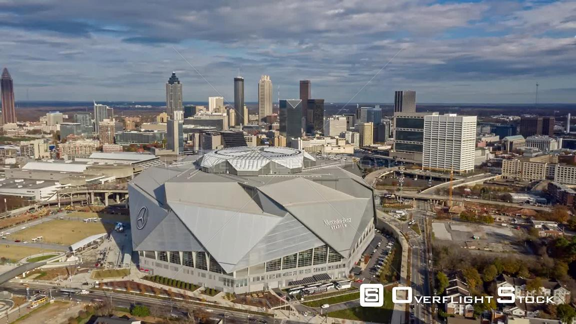 Atlanta Aerial Hyperlapse rotating around MercedesBenz Stadium and then flying over toward downtown cityscape with clouds