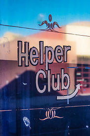 Helper Club Sign on Window in Helper, Utah