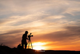 Silhouette of a filmmaker at The flaming Cliffs, Bayanzag in the South Gobi Desert, Mongolia
