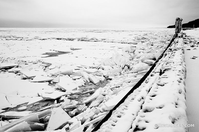 ICE FROZEN LAKE MICHIGAN POLAR VORTEX WINTER CHICAGOLAND ILLINOIS BLACK AND WHITE