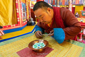 A monk doing a sand mandala at the Gandantegchinlen Monastery, Monglia's largest functioning Buddhist monastery in Ulaanbaata...