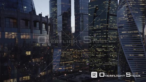 Dusk Closer Fly by MBCC With City Lights. Moscow Russia Drone Video View