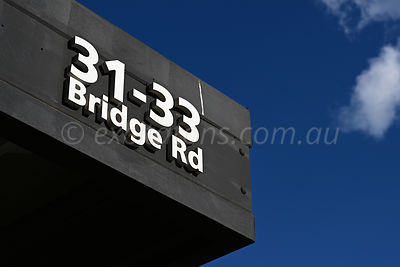 Shop address sign, Richmond, Victoria, Australia.