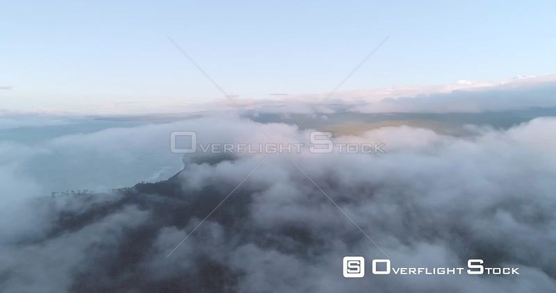Fly Through Clouds Looking Back at Fox Glacier Mountain Range New Zealand West Coast