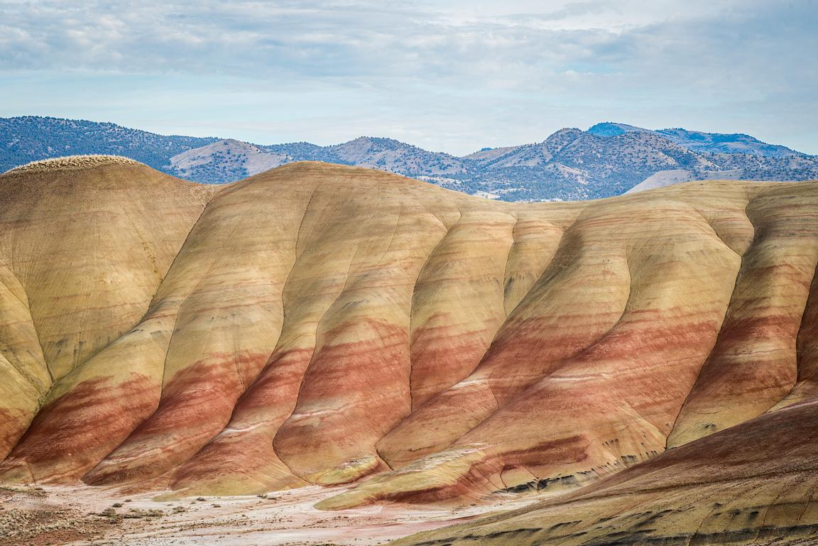 Colourful bands of vocanic ash create dramatic scenery in the Painted Hills of Oregon, part of the John Day Fossil Beds Natio...