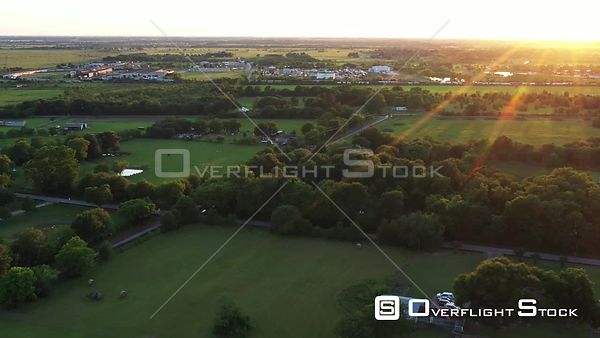 Flying toward an Industrial Area with Sunset Lens Flare, Hockley, Texas, USA