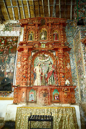 Carved wooden side altar with statues of the Holy Family inside the church of the Señor de la Cruz, Carabuco, La Paz Departme...