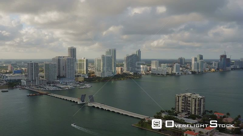 Miami Florida Flying over bay panning with cityscape, islands and south beach views.