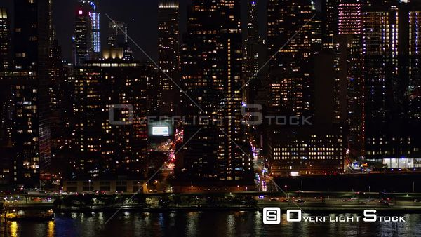 NYC New York High to low nighttime detail view of Midtown Manhattan cityscape with East River and FDR views