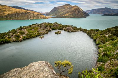 Lake on Mou Waho Island in Lake Wanaka. The milky blue of Lake Wanaka was due to unusually high rainfall in the glacial areas...