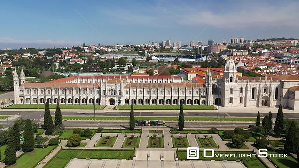 Aerial reverse of Jerónimos Monastery revealing Empire Square, in Belém, Lisbon, empty streets During Covid-19 Pandemic Portugal