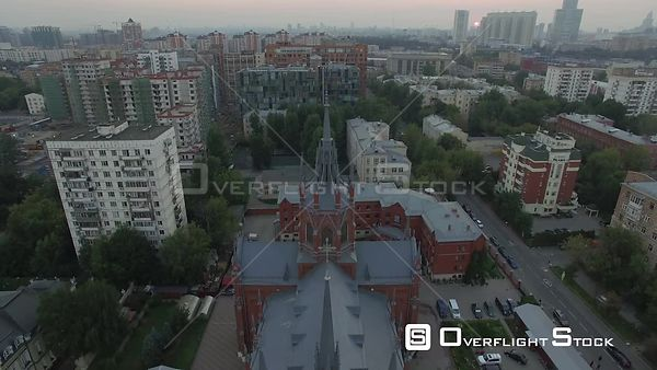 Pass Over Romancatholic Cathedral With Camera Turn. Moscow Russia Drone Video View