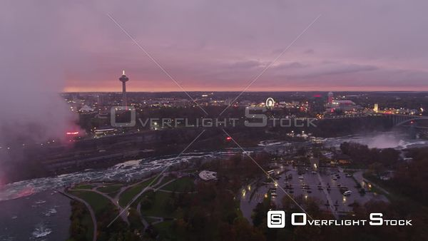 Niagara Falls Ontario Wide scenic panoramic view of Horseshoe Falls Park cityscape at sunset