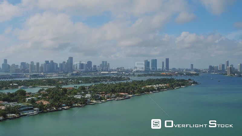 Miami Florida Flying over bay panning with cityscape and multiple island views.