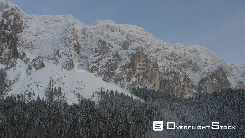 Establishing shot, going up of a limestone mountain, winter time, Piatra Craiului, Romania