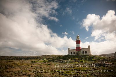 The Cape Agulhas Lighthouse stands on a hill at the Southernmost tip of Africa
