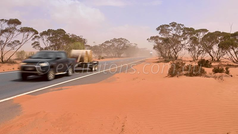Drift sand encroaching onto Sturt Highway.