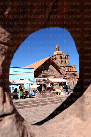 San Pedro church framed in hole in modern art sculpture in main square, Tiwanaku, La Paz Department, Bolivia