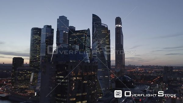 Dusk Fly Pass by MBCC With City Lights. Moscow Russia Drone Video View