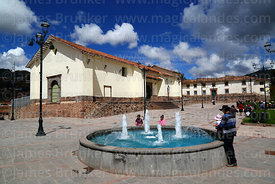 Fountain in Plaza Santa Ana and Santa Ana church, Cusco, Peru
