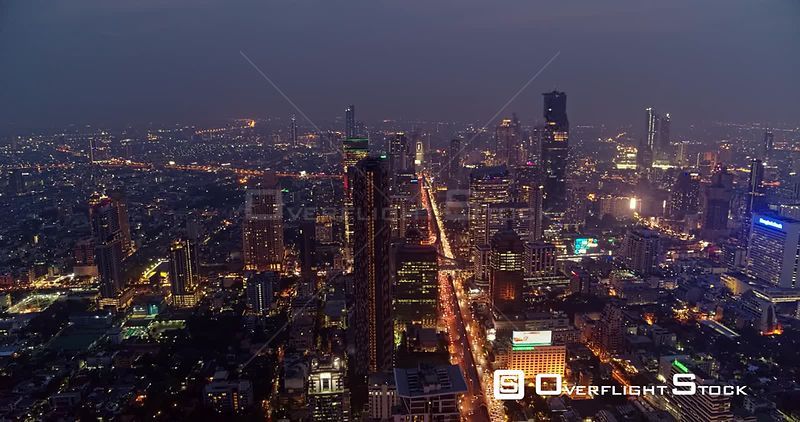 Thailand Bangkok Aerial Slow, high cityscape view following path of traffic at dusk