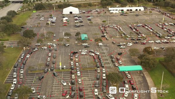 People in Cars Waiting for Covid 19 Vaccine Shot Miami Florida Aerial Pov