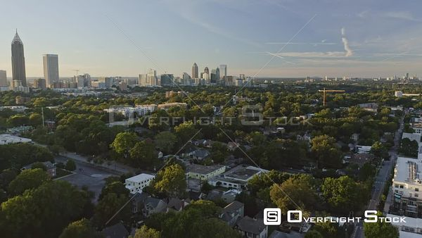 Atlanta Flying over Old Fourth Ward district into bright Midtown skyline and through