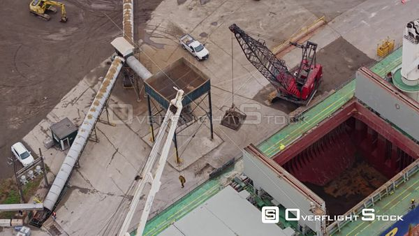 Hamilton Industrial Sector Ontario Panning birdseye close up of crane moving material from ship to conveyor belt