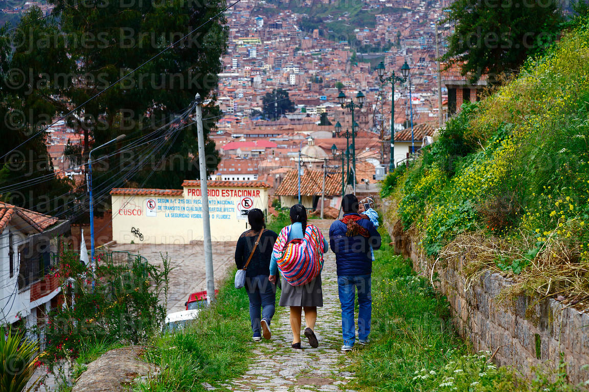 Local people walking along section of Qhapaq Ñan at Paqlachapata, the start of the former Inca road to Antisuyu, Cusco, Peru