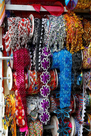 Detail of beads and embroidered borders for costumes for sale, Cusco, Peru