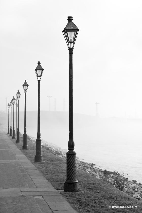 STREET LAMPS BY MISSISSIPPI RIVER NEW ORLEANS LOUISIANA BLACK AND WHITE VERTICAL