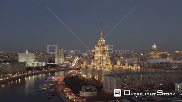 Dusk Flight Sideways Over Moscow Riverbank and Historical Building of Radisson Sas Hotel With City Lights. Moscow Russia Dron...