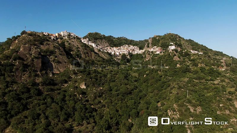 Aerial pull out view of the hilltop town of Motta Camastra in Sicily. Italy