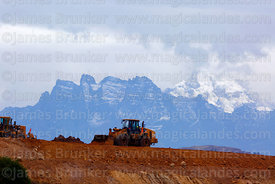 Heavy machinery working moving earth at the site of the planned new international airport for Cusco and Machu Picchu, Chinche...