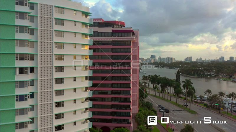 Aerial rise reveal Miami Beach Collins Avenue condominiums on the beach