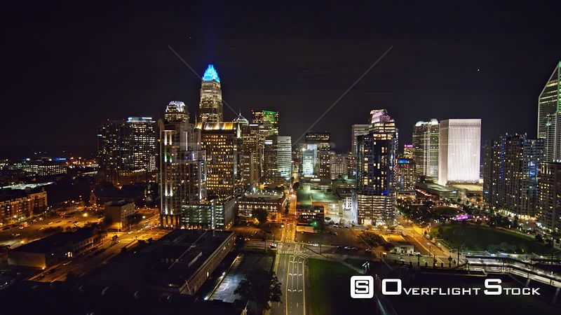 North Carolina Charlotte Aerial Flying low through downtown cityscape at night