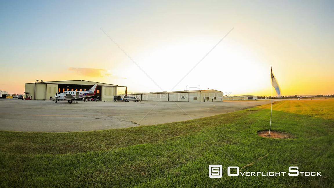 Skydive panning time lapse of hanger and landing area during sunset.