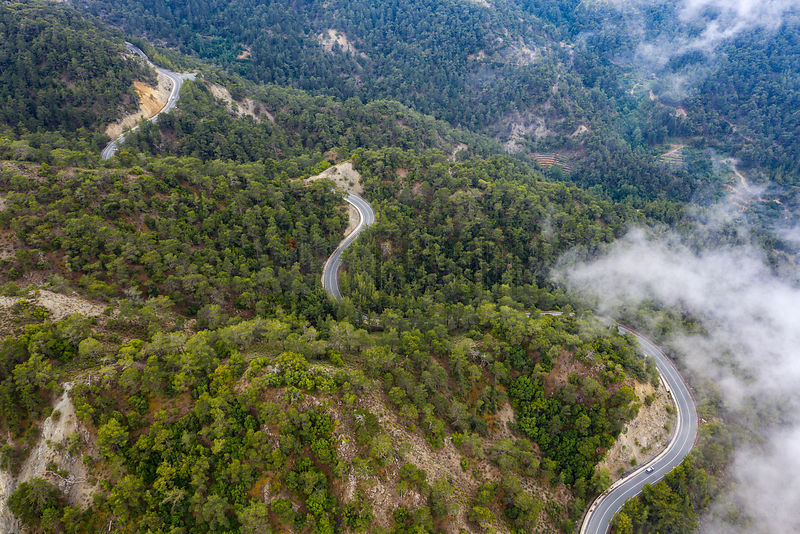 Aerial View of a Road Winding through the Troodos Mountains