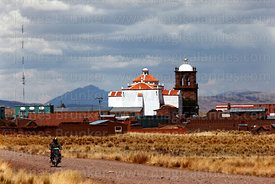 View across altiplano to church and village of Jesus de Machaca, La Paz Department, Bolivia