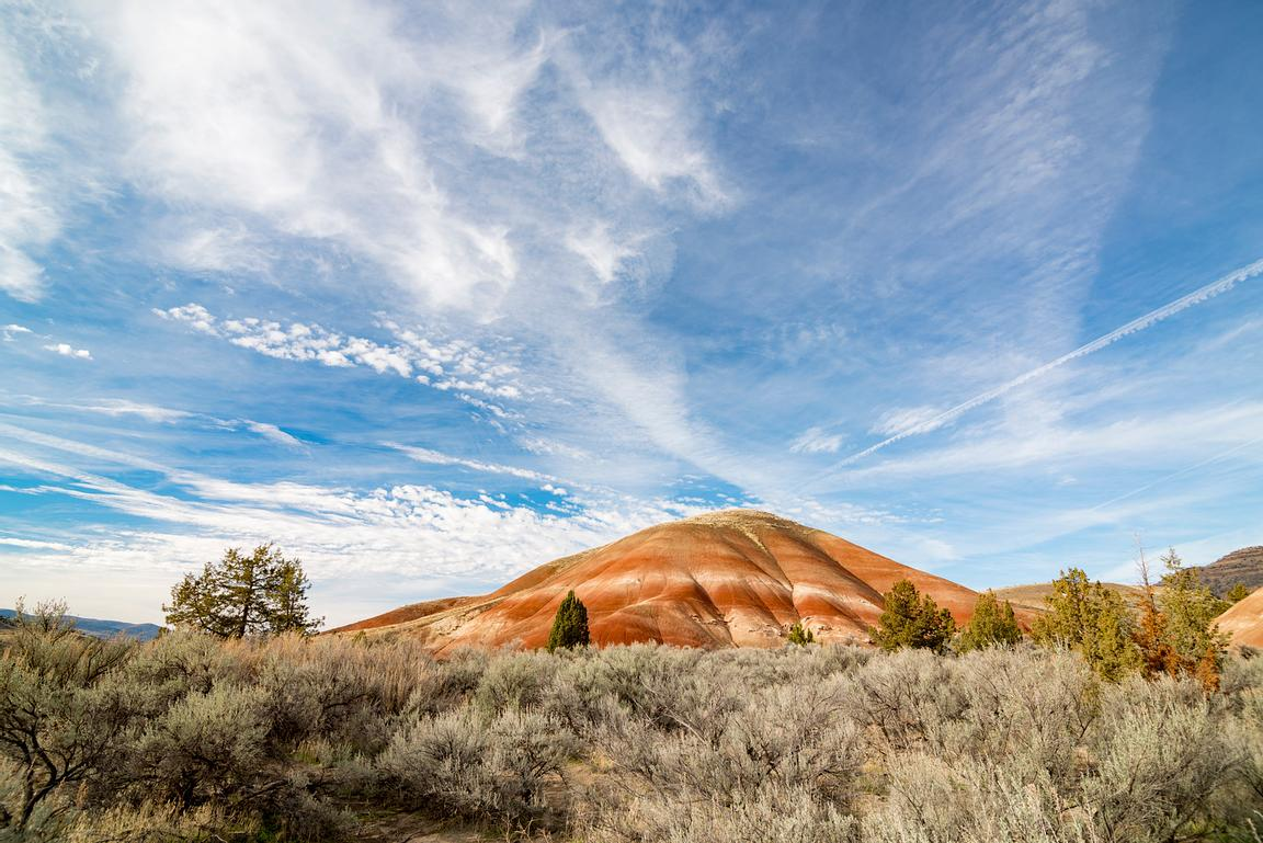 Colourful mountains and sage brush create dramatic scenery in the Painted Hills of Oregon.