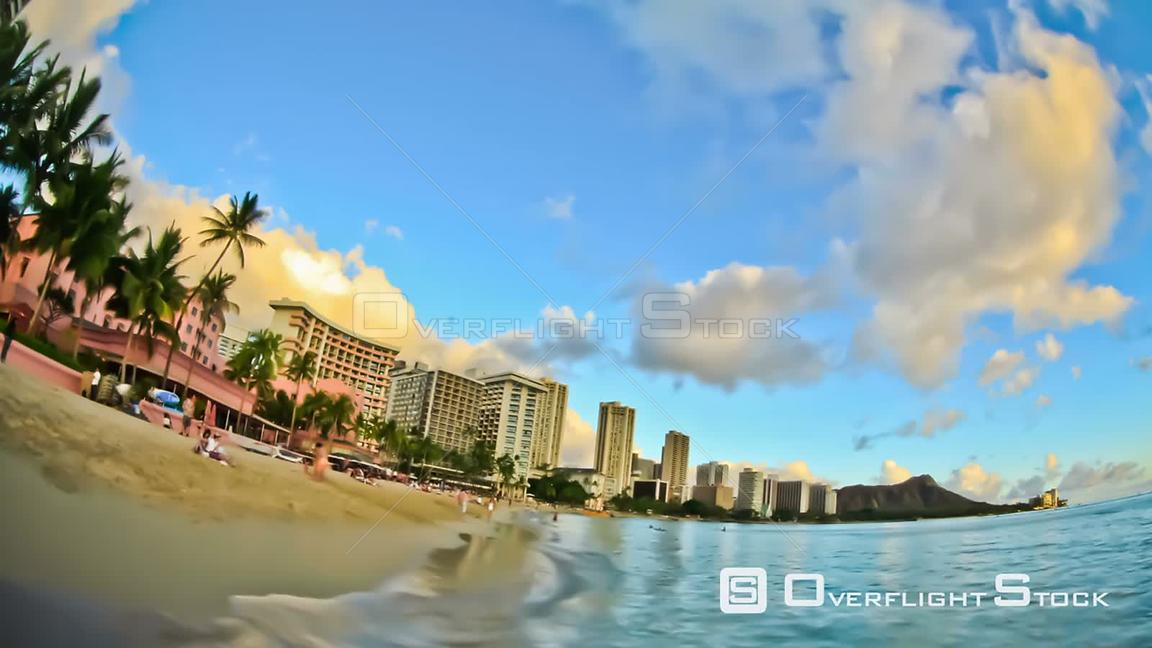 Beach time lapse clip during sunset in Waikiki. Hawaii