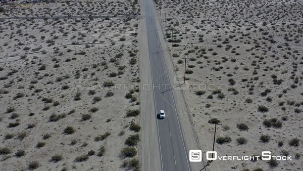 Car Tracking Through Wind Turbines In Palm Springs Desert California Drone Aerial View