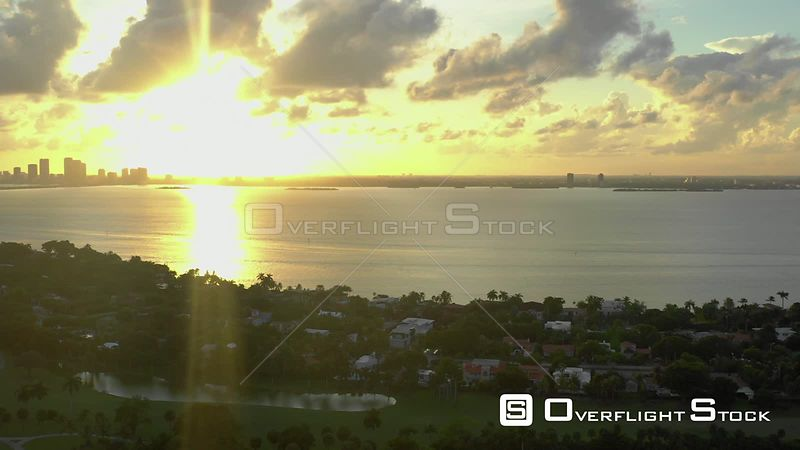 Sunset over Miami Beach Biscayne Bay aerial drone shot 4k